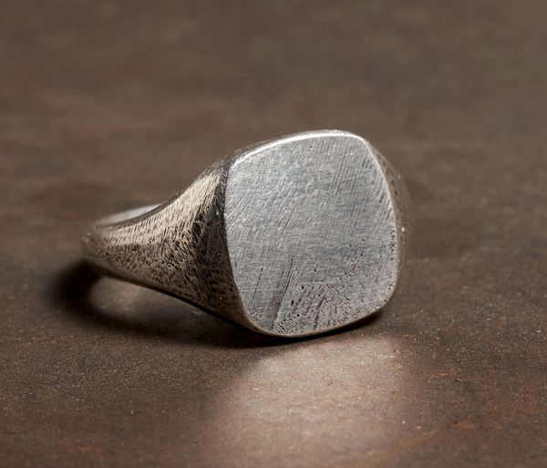signet ring scratched