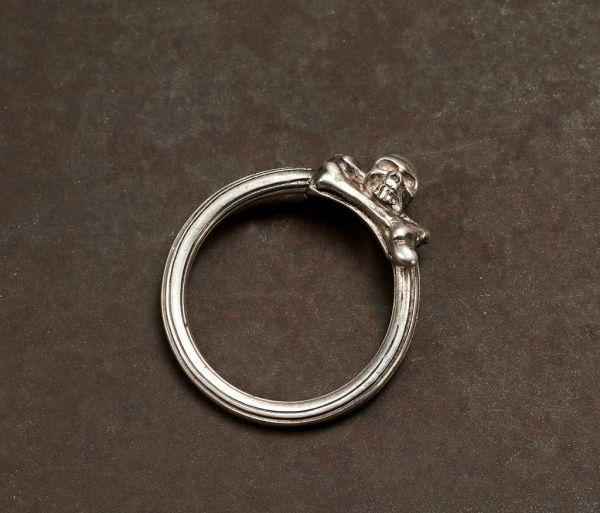 ring symbol skull