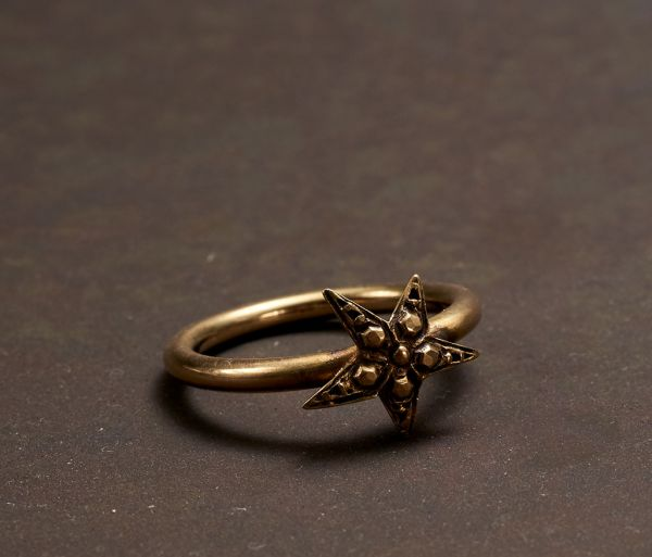 ring symbol star gold
